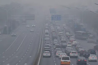Northwest China hit by sandstorm as Beijing is smothered in smog