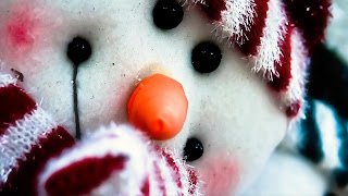 cute-looking-snowman-closeup-image-for-android-mobile.jpg