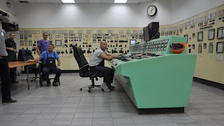 Workers in the control room of Kosovo A, a Tito-era coal plant the government wants to replace (Photo Credit: Karl Mathiesen) Click to Enlarge.
