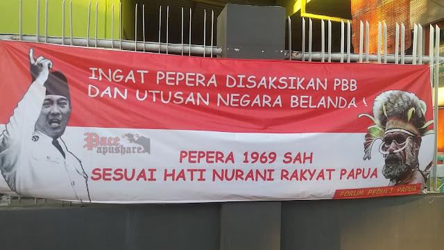May Day 2018  dan spanduk propaganda di asrama mahasiswa Papua Surabaya