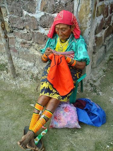 Kuna woman making a mola