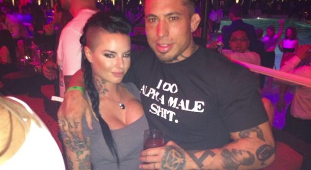 War Machine posing with then girlfriend porn star Christy Mack.