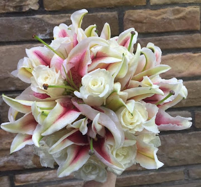 Pink and white rose and lily prom or wedding clutch bouquet by Stein Your Florist Co.