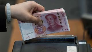 China Considers Changing Yuan Fixing Formula to Curb Swings