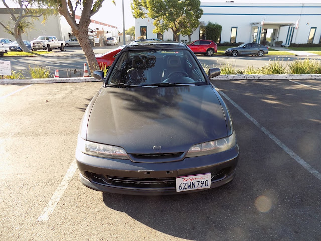 Integra with faded paint before overall paint job at Almost Everything Auto Body.