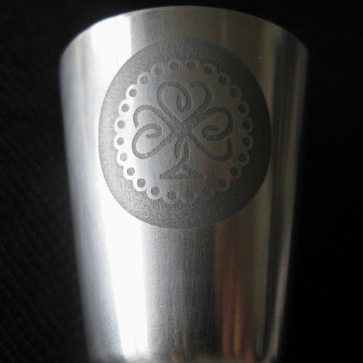 Stainless Steel Shot Glasses Close Up.  Etched with Edinburgh Etch Solution (Ferric Chloride) using Vinyl Resists Cut with Silhouette Cameo.  Tutorial by Nadine Muir for Silhouette UK Blog