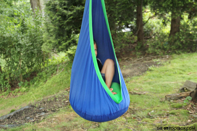 Use a sensory swing outside as part of a sensory diet for calming sensory input.