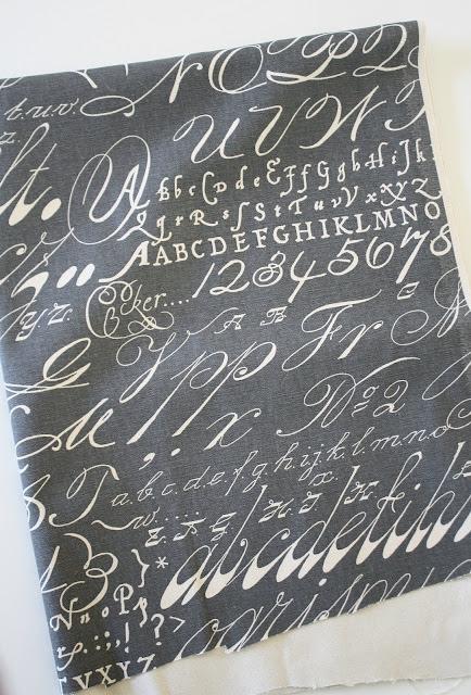 Gray alphabet print fabric