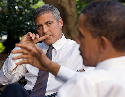 President Barack Obama discusses the situation in Sudan with actor George Clooney during a meeting outside the Oval Office, Oct. 12, 2010.