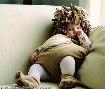 Cute baby dressed in lion.