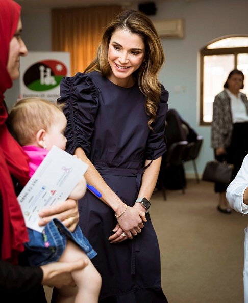 Queen Rania visited the Open Free Medical Day event at Zai in Al Balqa' Governorate. Queen Rania wore ruffled dress