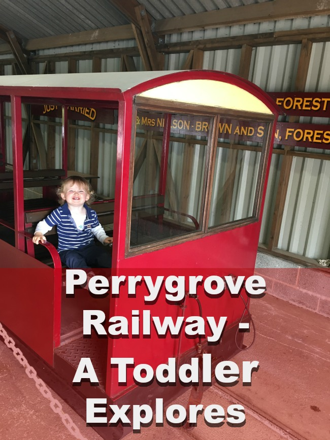 Perrygrove-Railway-A-Toddler-Explores-Toddler-sat-in-carriage-with-text