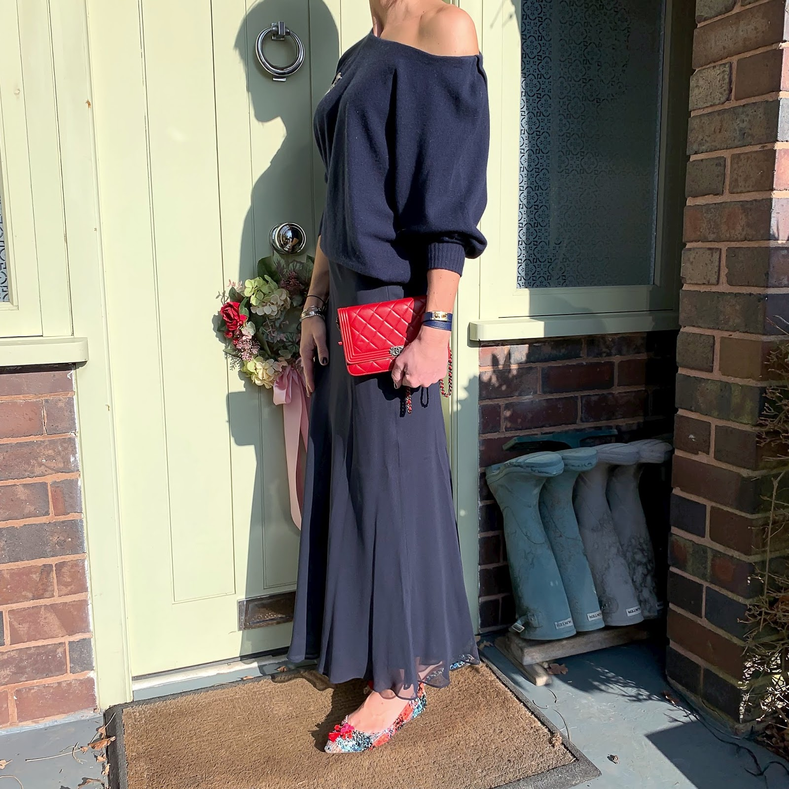 my midlife fashion, iris and ink off the shoulder cashmere jumper, vintage chanel brooch, chanel wallet on chain, peter hahn skirt in 100% silk, j crew pointed flat tassel shoes