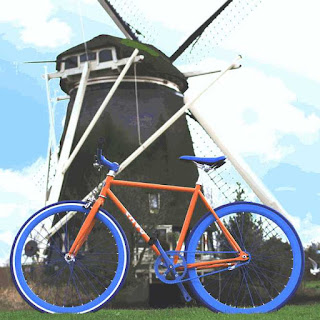 netherlands, bike in front of old mill