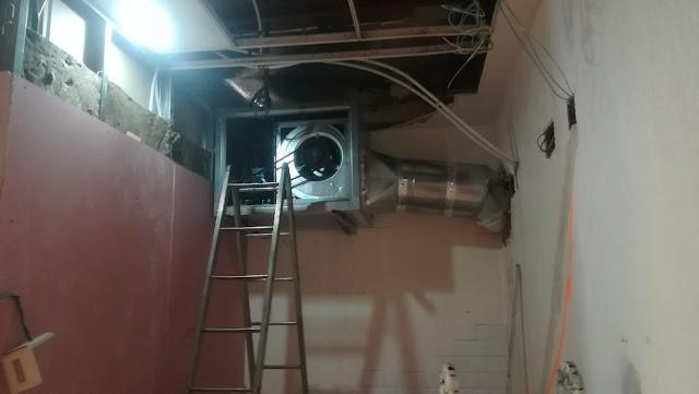 foto dos campanas unidas a motor de extracción