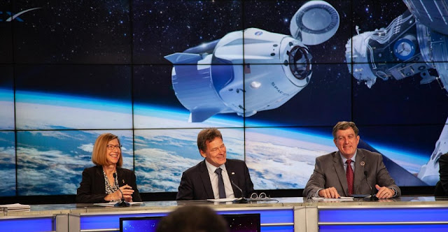 In Kennedy Space Center's Press Site auditorium, agency and industry leaders speak to members of the media on Friday, Feb. 22, during the post-flight readiness review briefing for the SpaceX Demo-1 Commercial Crew Program (CCP) mission to the International Space Station. From left are: Kathy Lueders, manager, NASA Commercial Crew Program; Hans Koenigsmann, vice president, Build and Flight Reliability, SpaceX; and Kirk Shireman, International Space Station Program manager. The inaugural uncrewed flight of the SpaceX Crew Dragon, known as Demo-1, is targeted to lift off from Kennedy's Launch Complex 39A on Saturday, March 2. EST. A SpaceX Falcon 9 rocket will launch the Crew Dragon on a mission designed to validate end-to-end systems and capabilities, leading to certification to fly crew. Credit: NASA/Chris Swanson