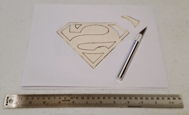 Attaching the superhero logo patch - step 3