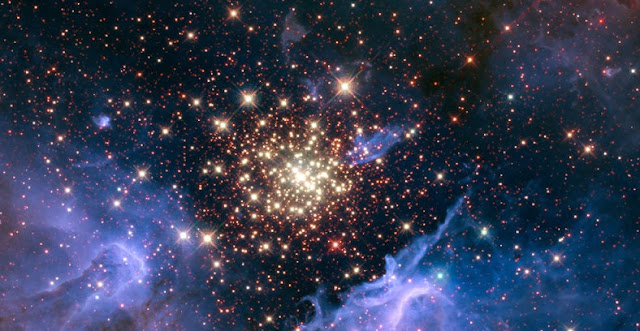 A cluster of massive stars seen with the Hubble Space Telescope. The cluster is surrounded by clouds of interstellar gas and dust called a nebula. The nebula, located 20,000 light-years away in the constellation Carina, contains the central cluster of huge, hot stars, called NGC 3603. Credits: NASA/U. Virginia/INAF, Bologna, Italy/USRA/Ames/STScI/AURA