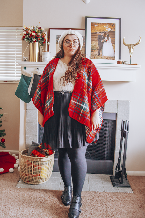 Tartan plaid shawl, white 3/4 sleeve sweater, white knit beret, black pleated skirt, black tights, black booties