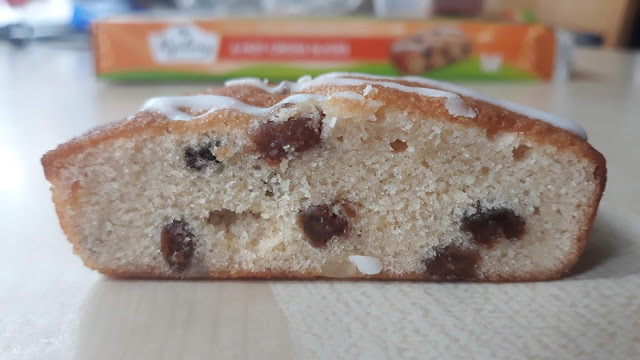 Hot cross bun slice with raisins, fruit and a drizzle of icing on the top