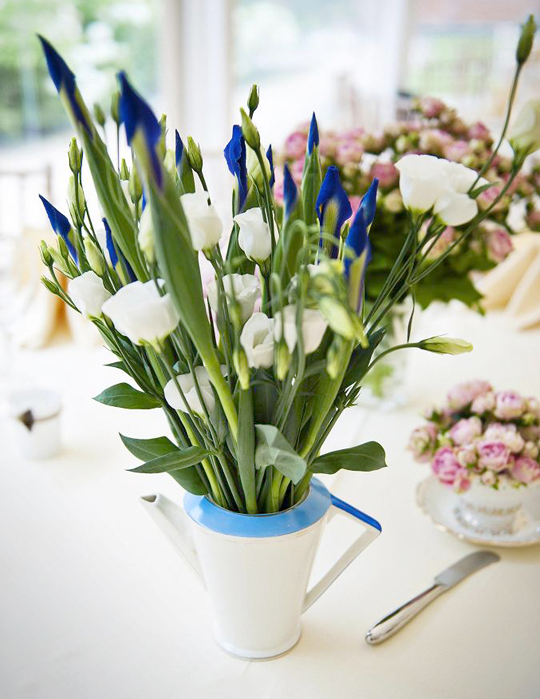 blue and white flowers in a vintage coffee pot
