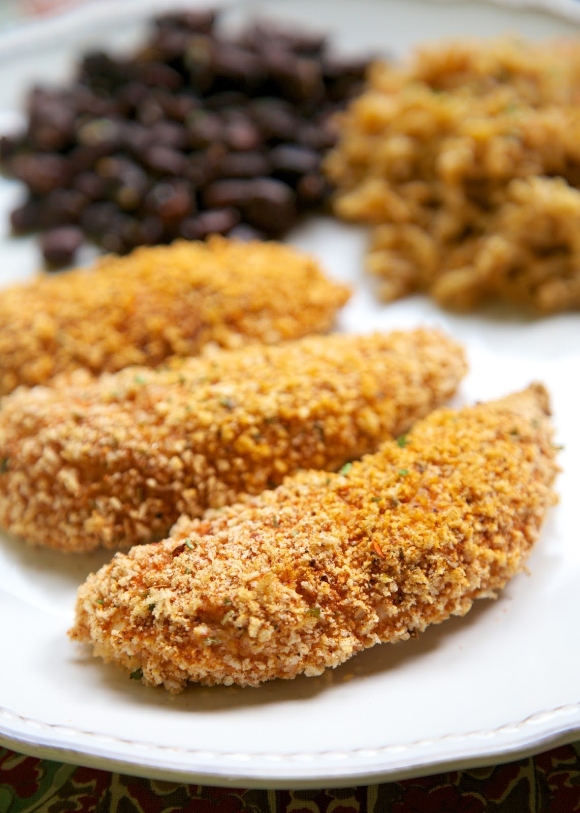 Cool Ranch Chicken Tenders recipe - chicken tenders coated in taco seasoning and ranch - baked not fried! Ready in 15 minutes!! Can coat tenders and freeze uncooked for later.