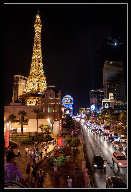 A view of the Vegas Strip At Night, showing the Eiffle Tower Restaurant.