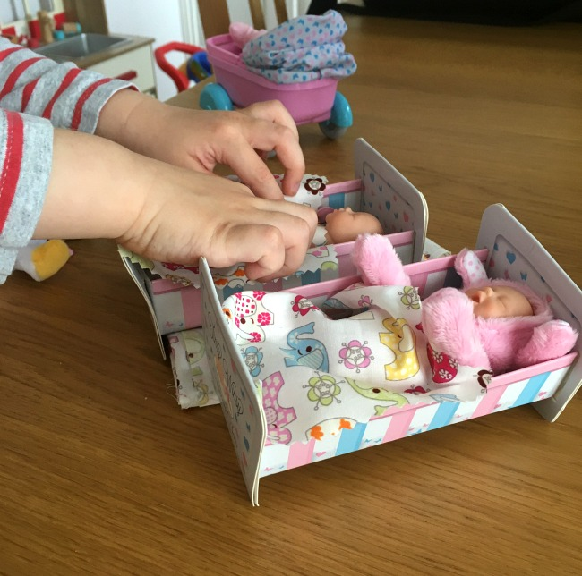 Tinsy-winsy-weeny-tot-doll-pram-boy-playing-with-dolls-in-cots