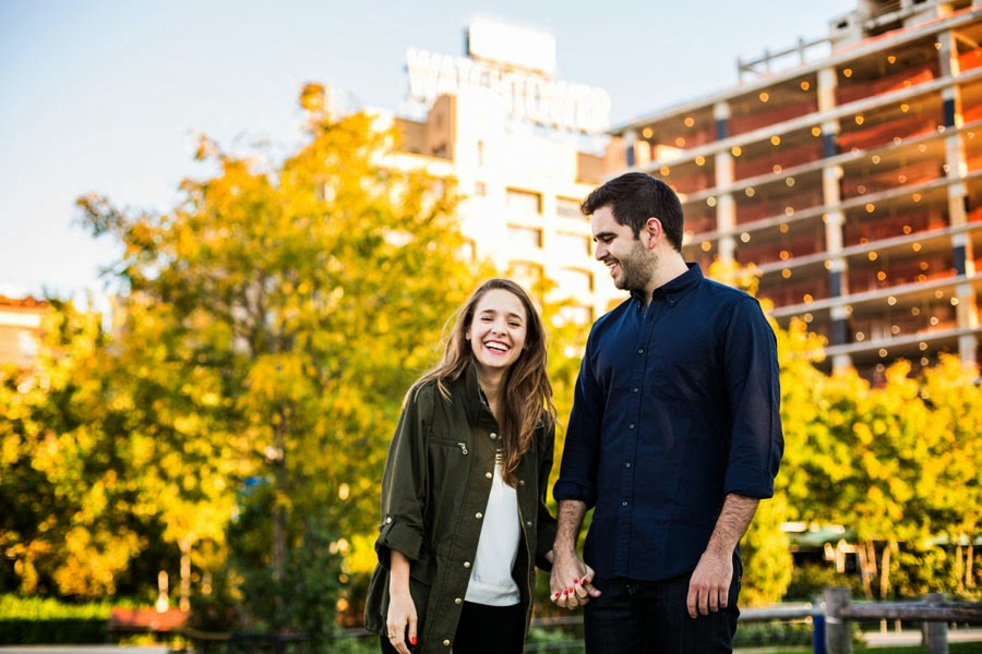 smiling, happy, lifestyle engagement photos with yellow fall leaves & watchtower DUMBO Brooklyn Bridge Park - www.cassiecastellaw.com