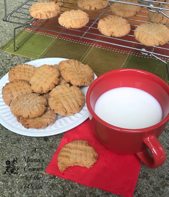 Peanut butter cookies on a plate with milk for dipping
