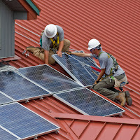 Workers install solar panels in Wayne National Forest. (Credit: Alex Snyder) Click to Enlarge.