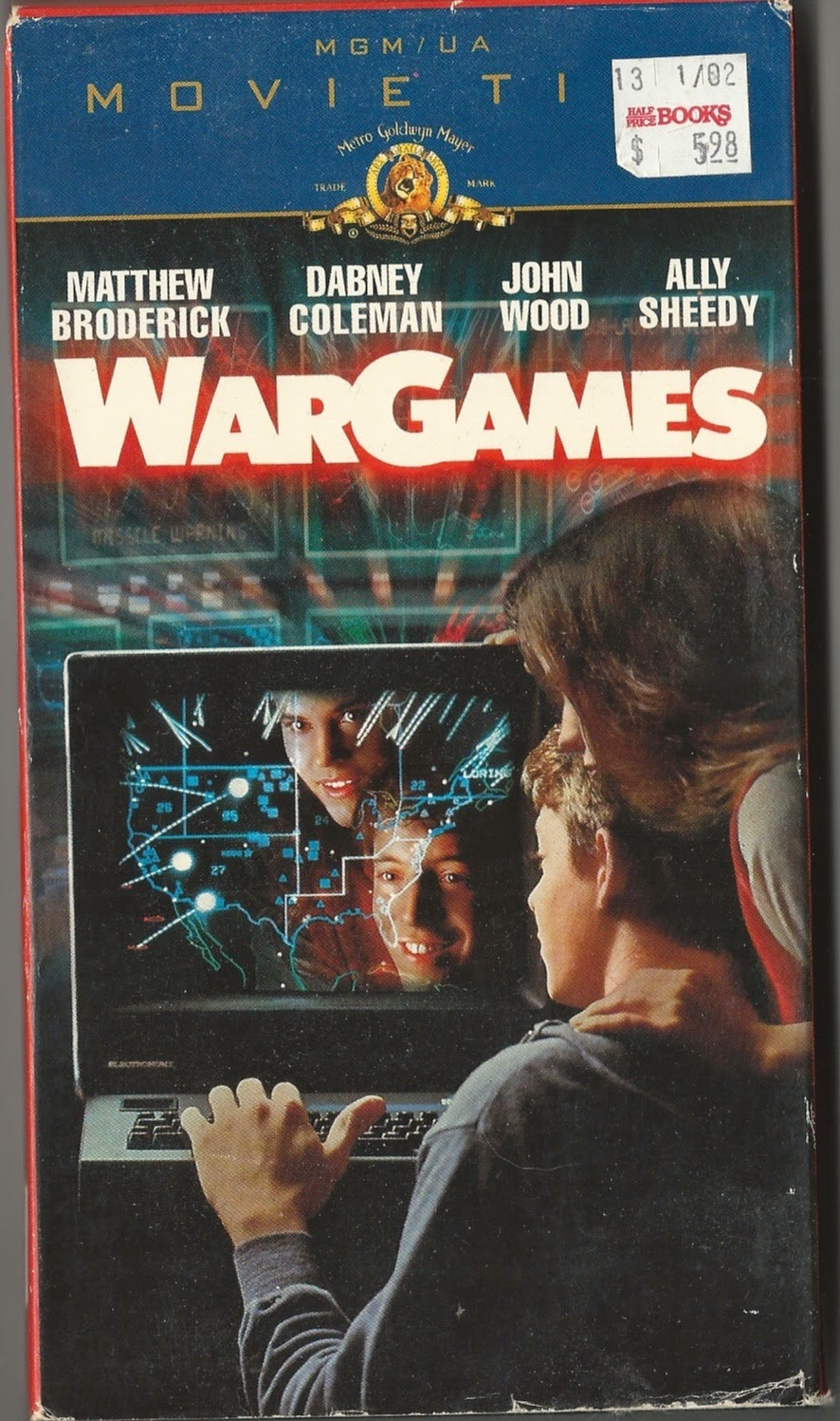 Box cover for VHS tape showing two teenagers at a computer about 1982.