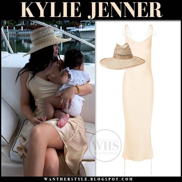 Kylie Jenner in beige silk slip orseund iris dress and gladys tamez straw hat summer celebrity style