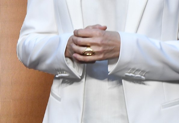 Queen Letizia wore a white blazer by Spanish fashion designer Felipe Varela, and Hugo Boss satin top, Hugo Boss black trousers