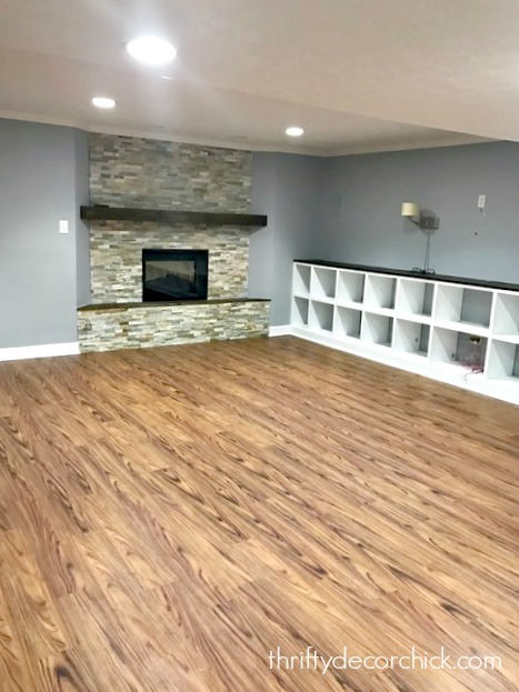 Basement with built in cubbies and stone fireplace