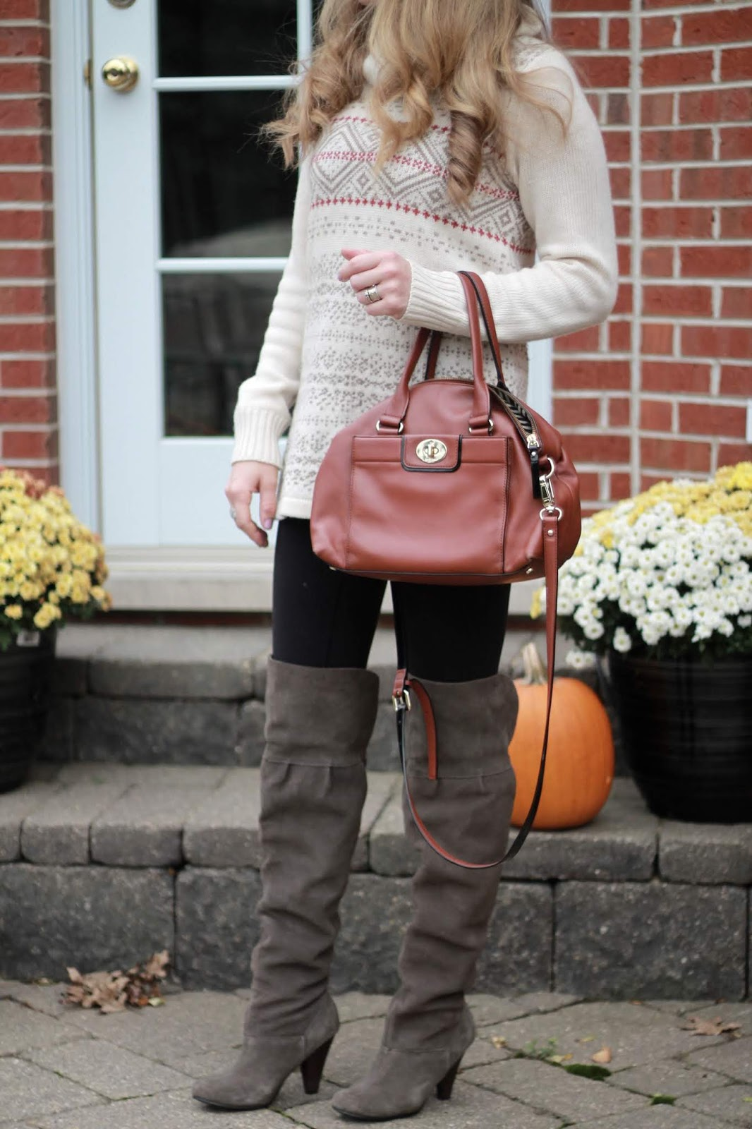 Aventura white fair isle sweater, black leggings, Kate Spade cognac satchel, grey OTK boots, camel fedora,