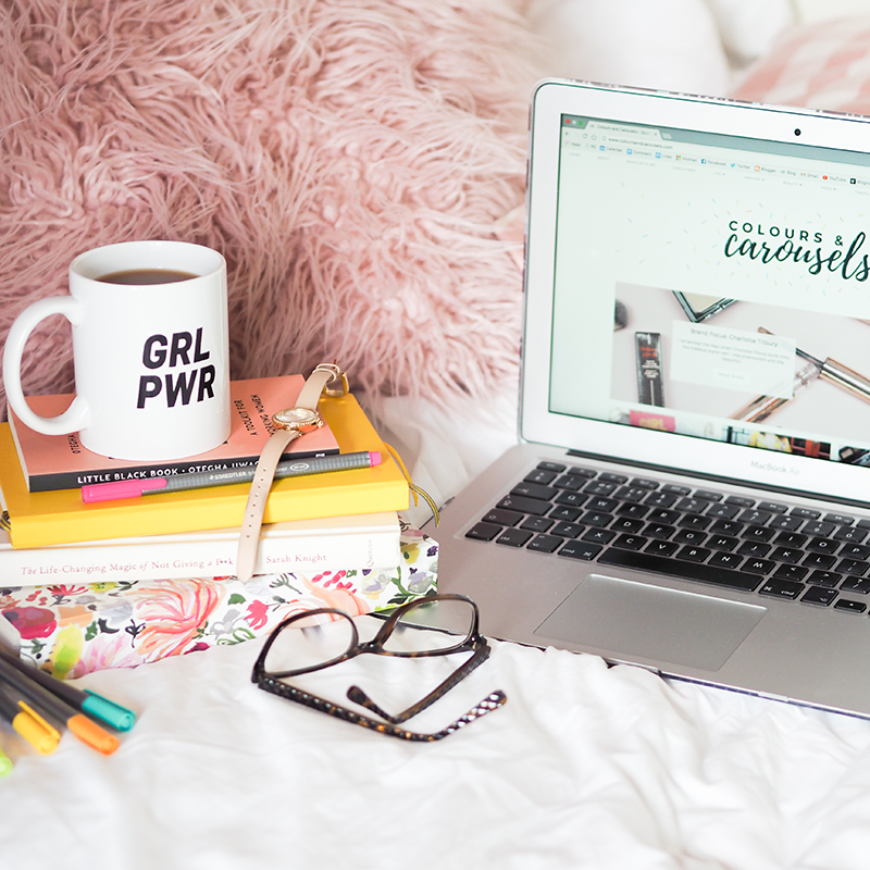 Open laptop and GRL PWR mug on pile of books| Colours and Carousels - Scottish Lifestyle, Beauty and Fashion blog