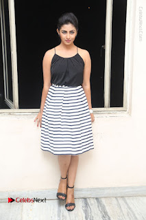 Telugu Actress Kruthika Jayakumar Stills in Short Dress at Intlo Deyyam Nakem Bhayam Success Meet  0259.JPG