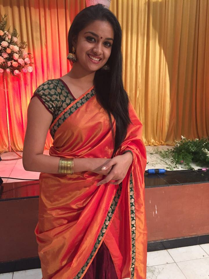 Actress Keerthi Suresh Sleeveless Photos In Red Saree
