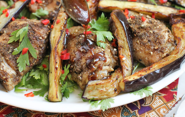 Food Lust People Love: Not your typical salad, this lovely roast za'atar chicken and eggplant salad combines fresh herbs with succulent chicken thighs and golden fried eggplant, drizzled with a tangy pomegranate molasses dressing.