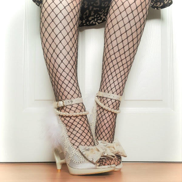 side angle of legs in Irregular Choice Tingle Tastic shoes and fishnet tights