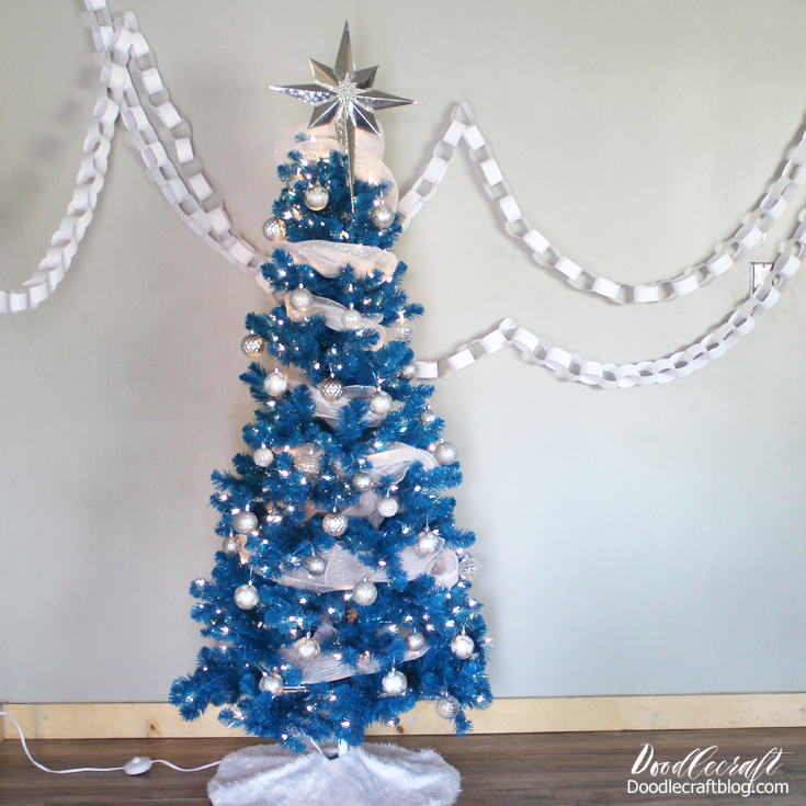 Silver Star Tree Topper On Blue Christmas Tree With Cricut Maker