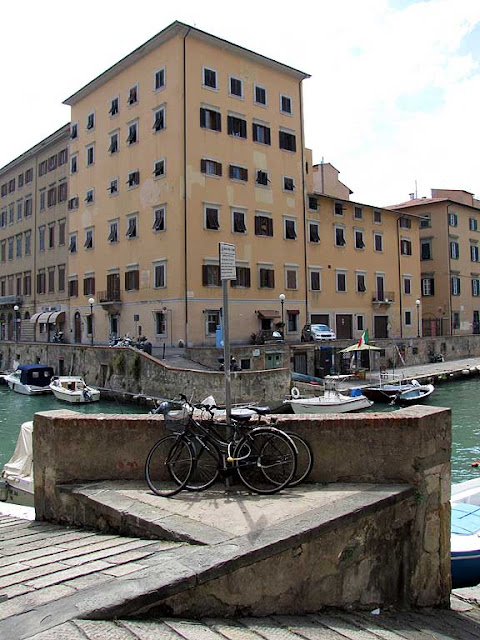 Locked bicycles with a view over a bend of the canal, Livorno
