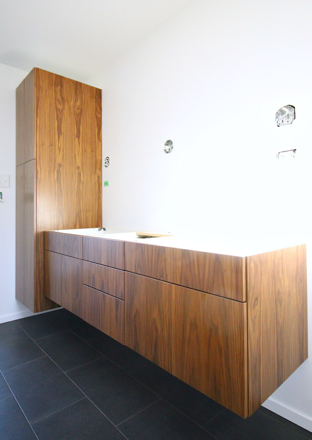 Wall mounted vanity and linen tower