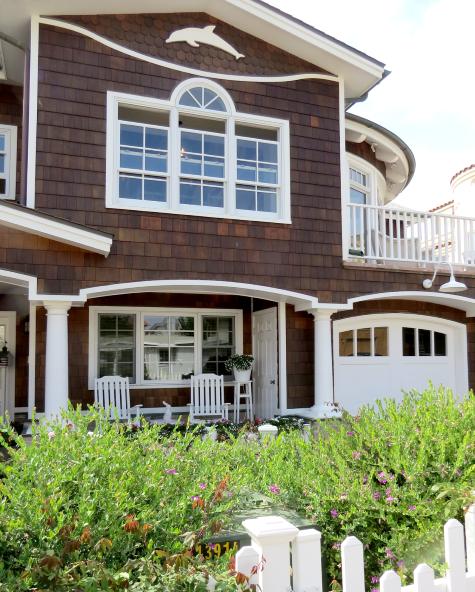 new California shingled home with dolpin wall decor