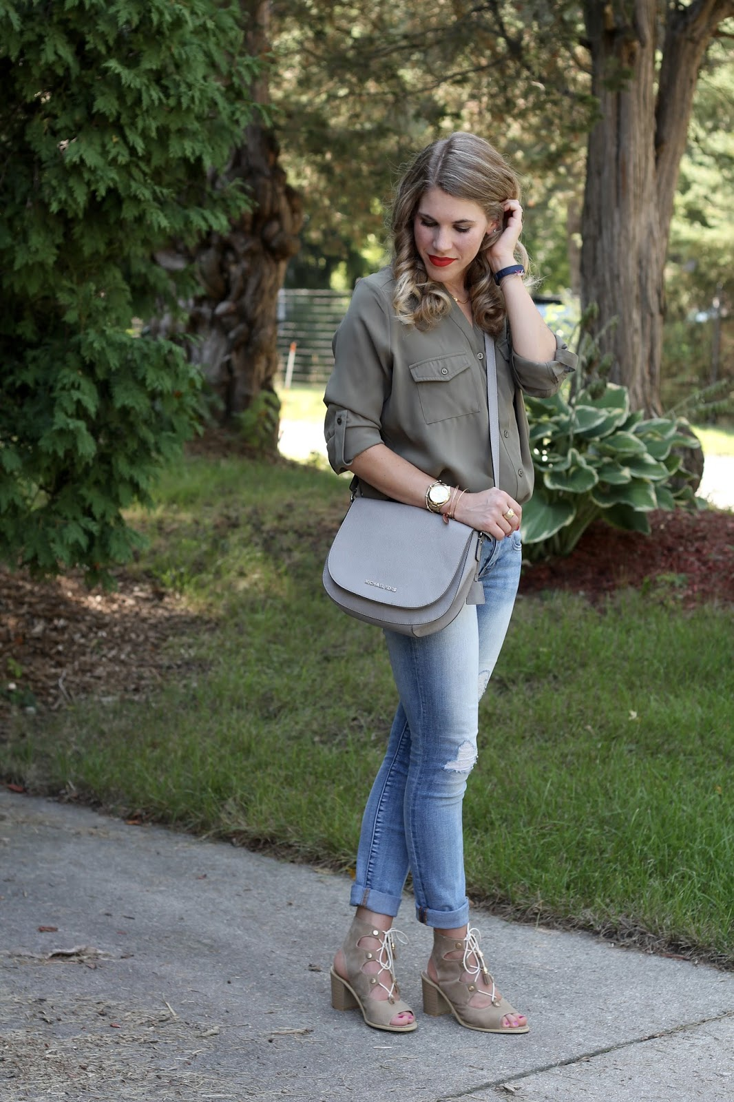 Tobi olive button up top, distressed jeans, grey Michael Kors saddle bag, lace up sandals