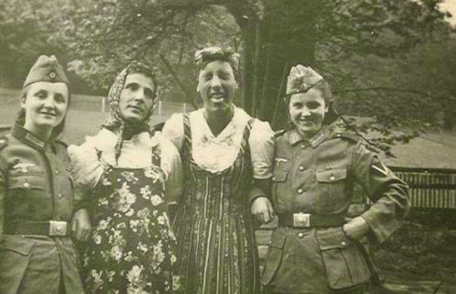 German soldiers exchanging their clothes with their girlfriends. Those uniforms really fit those women pretty well!