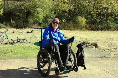 Photo of me in my mountain trike with Liggy attached at my side.