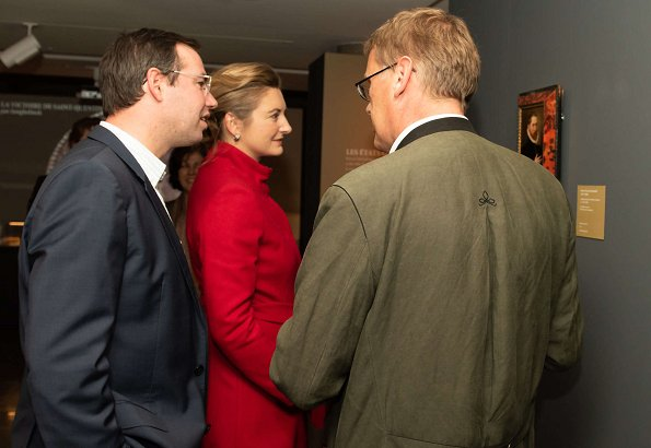 Duke Guillaume and Hereditary Grand Duchess Stéphanie at Night of Museums event. Stephanie wore red wool coat