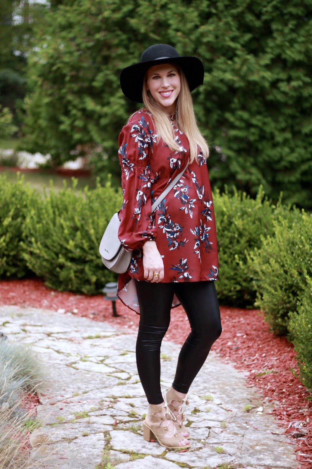 SheIn burgundy floral tunic, leather leggings, black floppy hat, taupe lace up sandals, fall maternity outfit